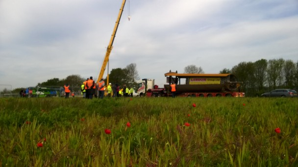 10th May 2015-The Memorial Spire arrives to a show of poppies